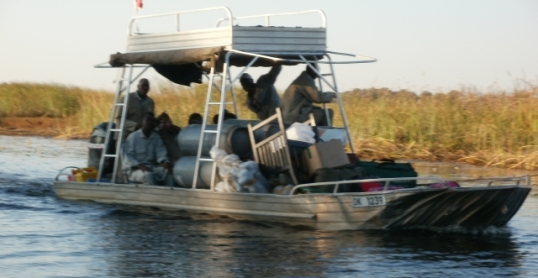 In the Okavango Delta a boat  is a good way to move your stuff