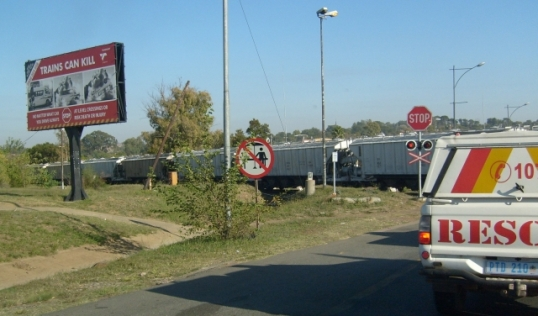 Train passing level crossing at Magaliesberg