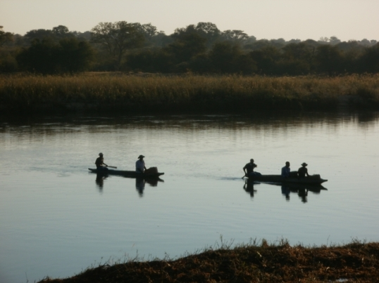 Crossing the Okavango River from Angola to Namibia, for the benefit of the photographer