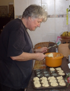 My wife Val putting muffin mixture into muffin pans, ready for baking