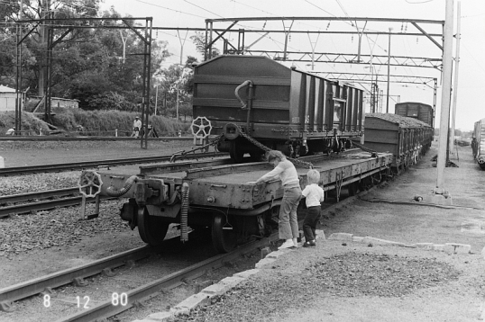Narrow-gauge truck riding piggy-back on a mainline train. Umlaas Road, 8 December 1980