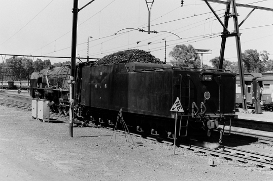 Steam locomotive hooking up to the assembled train
