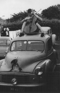 "Martin Goulding playing ""Nearer my God to thee"" on his Morris Minor, Miranda. Durban, 6 September 1965"
