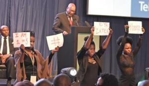 Silent protesters at President Jacob Zuma's speech at the IEC's final election results meeting